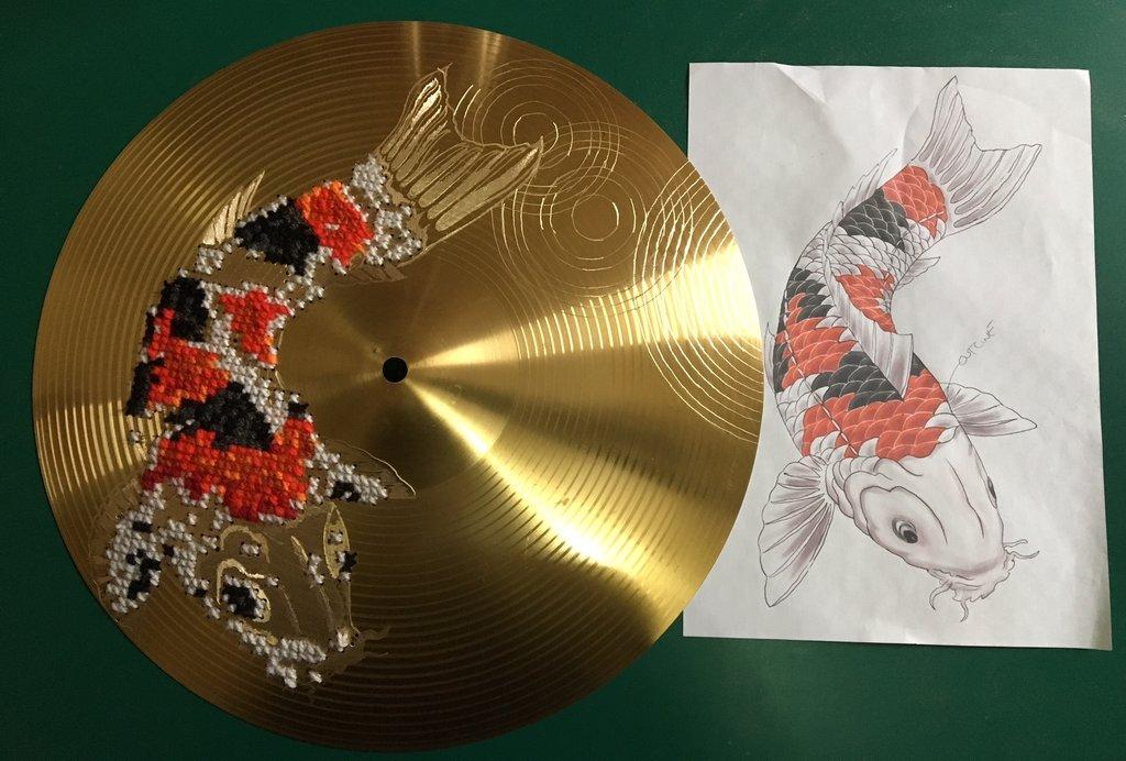 Cross Stitched Koi on a Drum Cymbal